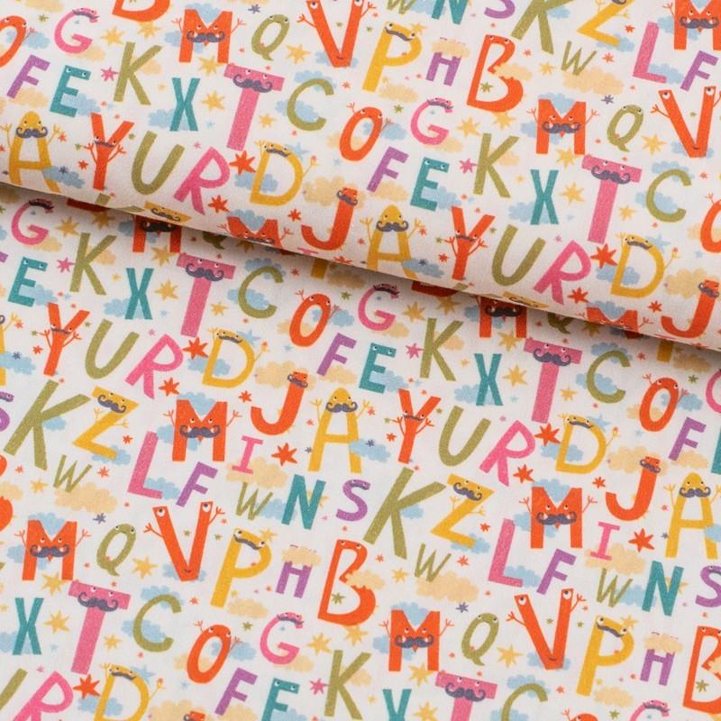 Tela de algodón con letras lomo