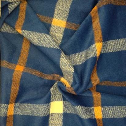 Tela de paño azul con cuadros blancos y naranjas arrugada