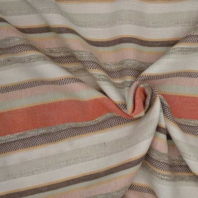 Tela de algodón de rayas de naranjas y beises arrugada