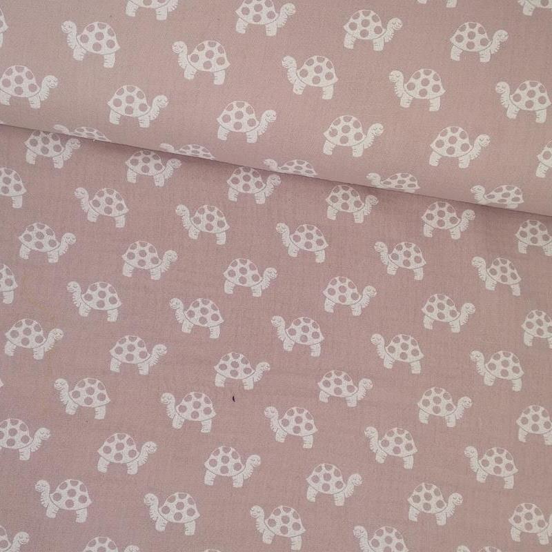 Tela de algodón rosa con tortugas blancas tubo