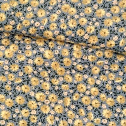 Tela de pana gris con flor amarilla tubo
