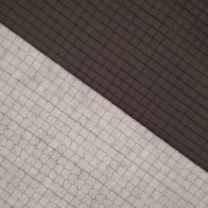 Tela de gofre acolchada gris textura