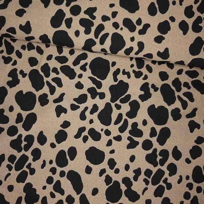 Tela de viscosa print animal dorado y negro lomo