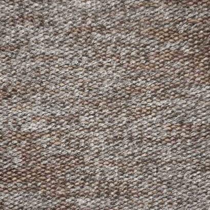 Tela de punto marrón y gris