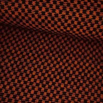 Tela de paño naranja y negra