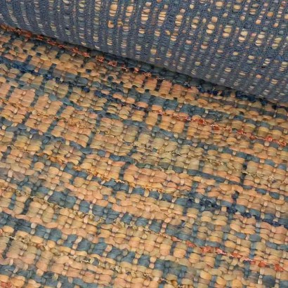 Tela de tramado de hilo en azules y naranjas lomo