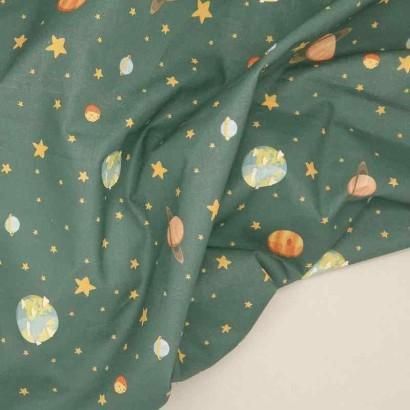 Tela de algodón con planetas arrugada