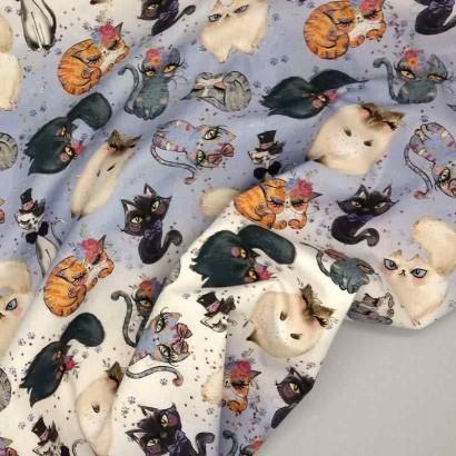 Tela de algodón con gatos arrugada