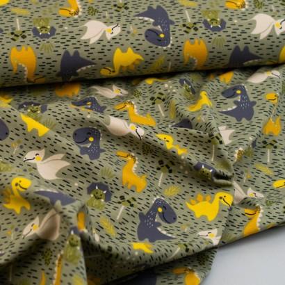 Tela de punto camiseta dinosaurios arrugada