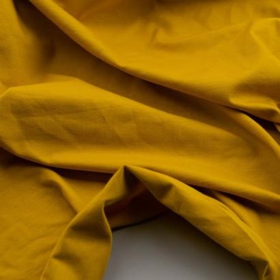Tela de punto camiseta lisa algodón mostaza arrugada